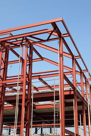 steelwork: Vertical view of a red steel building construction framework. Stock Photo
