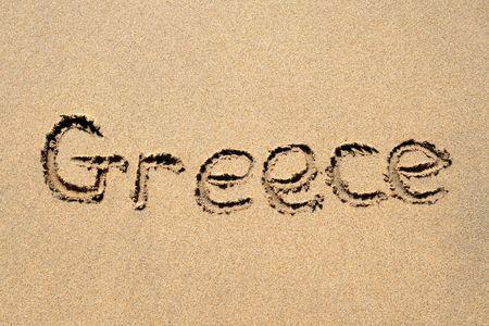 Greece, written on a sandy beach. photo