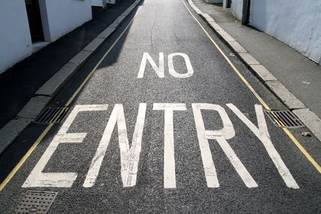no skid: No entry, written on a one way road. Stock Photo