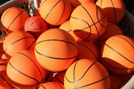 A close up of lots of basketballs. photo