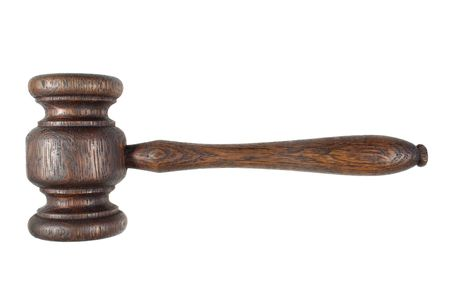 An old auctioneersjudges wooden hammer, isolated on a white background. Stock Photo