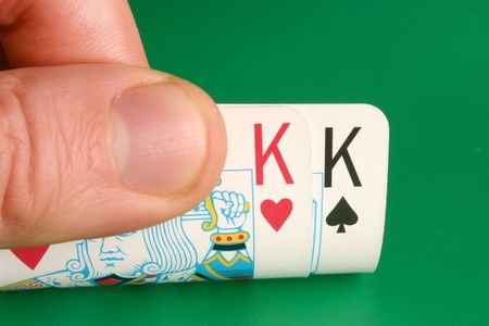 Looking at pocket Kings (Cowboys) during a poker game