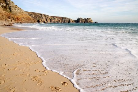 porthcurno: The tide coming in on a sunny day, Porthcurno, Cornwall, UK