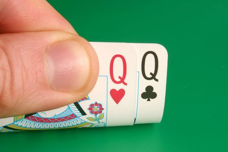 Looking at pocket Queens (Ladies) during a poker game