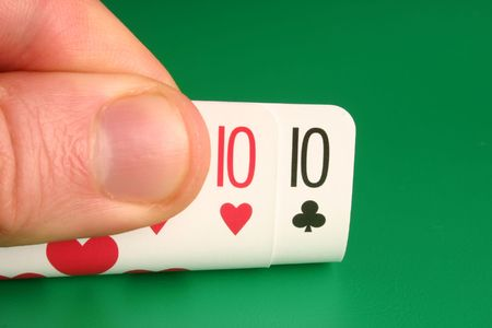 Looking at pocket tens during a poker game photo