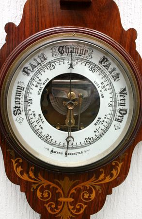 aneroid: An Old aneroid barometer, used to forecast the weather.