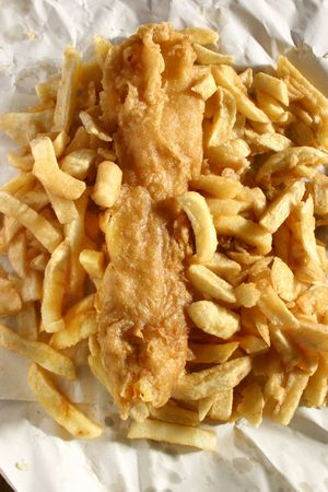 Battered fish and chips in paper, a traditional British favourite.