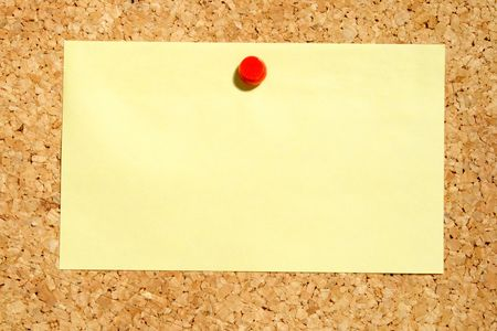 yellow pushpin: A yellow note held on a cork notice board with a red pushpin.