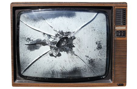 trashed: An old trashed TV with a smashed screen, isolated on a white background. Stock Photo