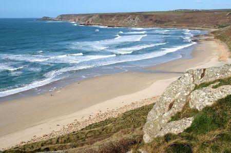 cornwall: Atlantic waves reaching the beach at Sennen Cove, Cornwall, UK Stock Photo