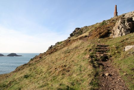 sentinel: The path to the Sentinel chimney, erected in 1875, Cape Cornwall. Stock Photo