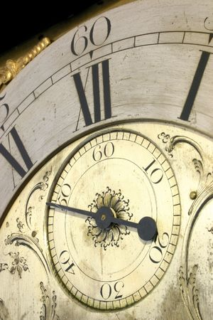 Close up of the face of an antique grandfather clock. Stock Photo