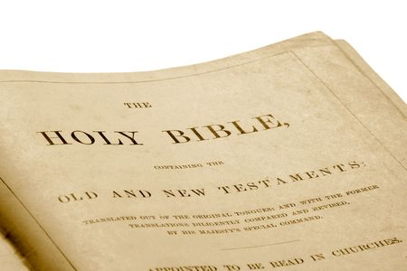 revised: Close up of the opening page of an antique bible printed in 1882.