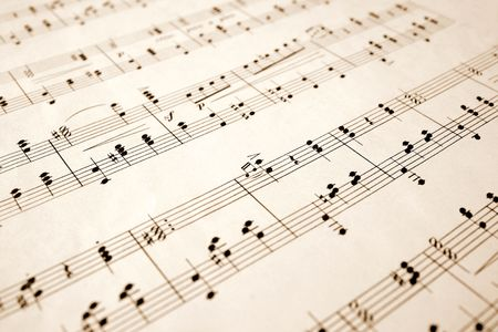 Close up of notes on an old sheet of music with shallow focus. photo