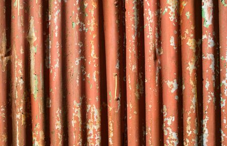 An old rusty corrugated iron fence photo