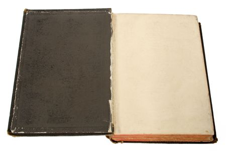 The inside cover of an old black book with space for text. photo