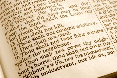 Close up of the 10 commandments in an old bible. Stock Photo