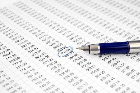 A circled number on a printed spreadsheet. Stock Photo