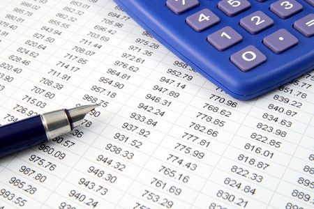 Studying financial numbers on a printed spreadsheet. Stock Photo
