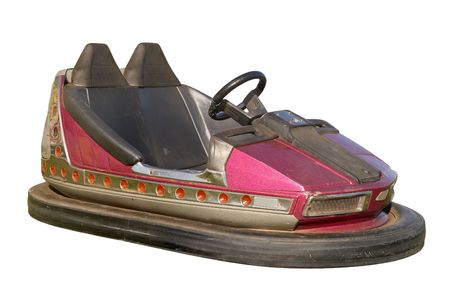 An old funfair bumper car, also know as a dodgem, isolated on a white background.