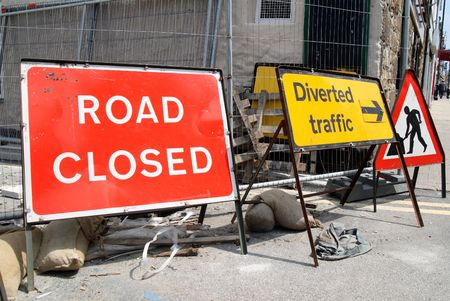 diversion: British roadworks with road closed and diverted traffic, signs.