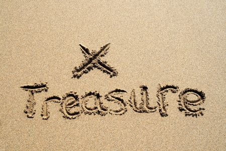 scraped: The word treasure written in the sand with an X marking the spot to dig.