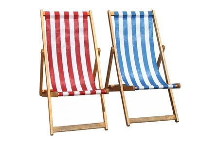 Two colorful deckchairs, isolated on a white background. Stock Photo