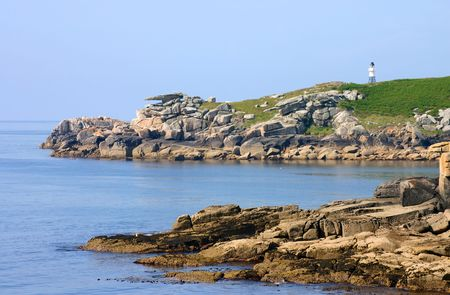 scilly: Penninis lighthouse and Pulpit rock, St. Mary�s, Isles of Scilly, Cornwall, UK Stock Photo