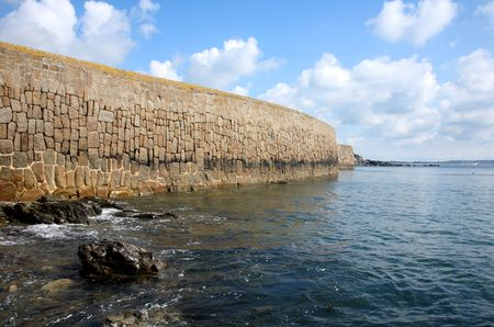 mousehole: The harbour sea wall, Mousehole, Cornwall, UK. Stock Photo