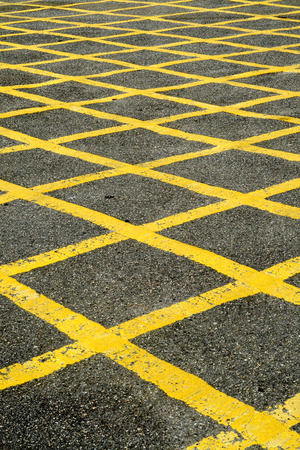 Close up of the yellow lines of a British road box junction. photo