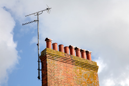 analogue: Old British chimneystack and an analogue TV aerial. Stock Photo
