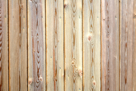 treated board: Close up of wooden fence panels.  Makes a good background.