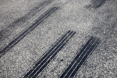 A close up of skid marks on a road. Stock Photo