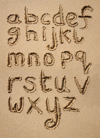 early childhood: The alphabet written in sand on a beach.