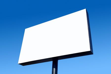 White blank billboard and a blue sky. Stock Photo