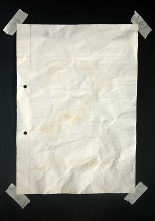 masking: An old piece of A4 lined paper stuck with masking tape to a blackboard.
