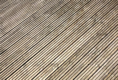 grooved: Grooved wooden garden decking close up.
