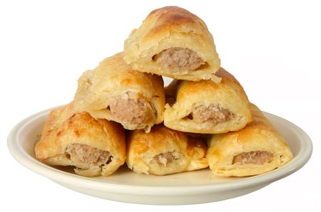 white sausage: A plate stacked with festive sausage rolls. Stock Photo