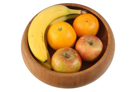varied: 4 types of Fruit in wooden bowl isolated on white background. Stock Photo