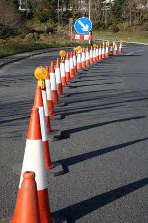 traffic cones: A row of traffic cones.