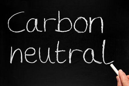 carbon neutral: Writing Carbon neutral on a blackboard.