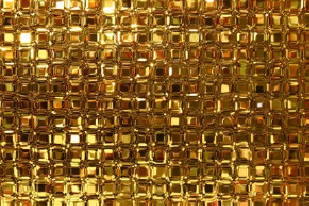 Close up of a glass blocks window with golden light colors. photo