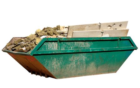 A skip full of building materials rubbish isolated on white. Stock Photo
