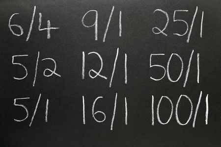 odds: Betting odds written on a blackboard. Stock Photo