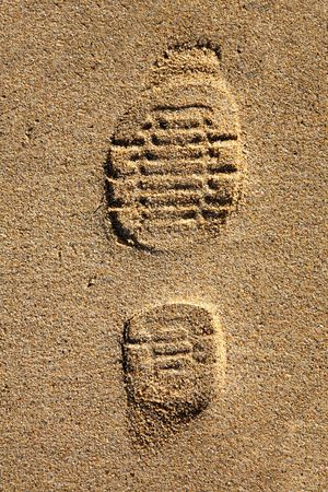 indentation: Shoe footprint in the sand. Stock Photo