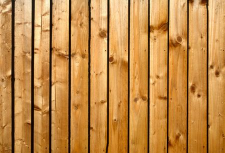treated board: Wooden fence close up background.