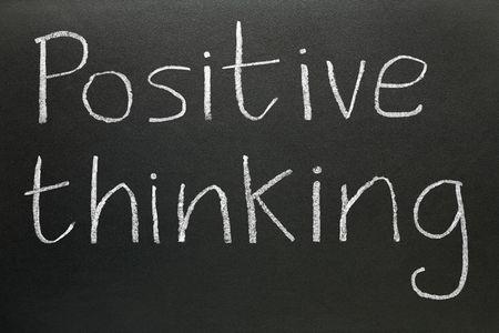 cliche': Positive thinking written on a blackboard.