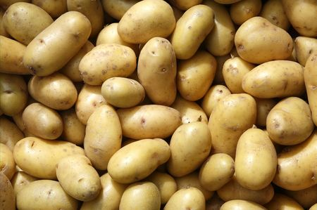 Close up of new potatoes outside a greengrocers. Stock Photo