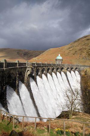 elan: Water overflowing a dam, Craig Goch reservoir, Elan Vally Wales. Stock Photo