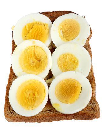 hard boiled: Slices of hard boiled egg on toast.